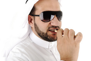 Arabic adult cleaning teeth with miswak
