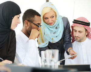 Arabic business people discussing on tablet pc