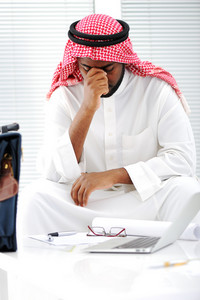 Arabic businessman stressed in crisis concerns