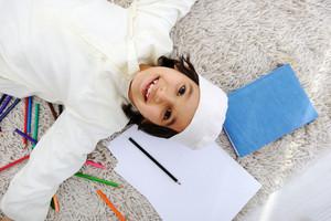 Arabic little boy doing homework at home