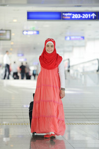 Arabic Middle eastern teenage girl traveling, airport transit