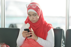 Arabic Middle eastern teenage girl using cell phone for messaging