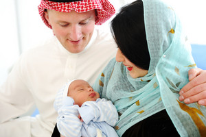 Arabic Mother and Father with baby at home