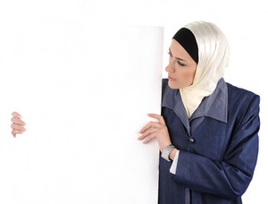 Arabic Muslim beautiful woman holding banner for your text