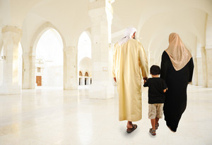 Middle Eastern family walking indoor