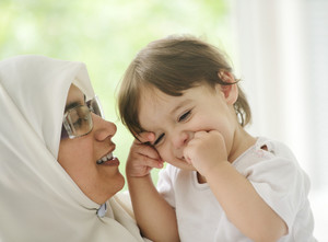 Arabic Muslim mother with baby