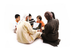 Middle Eastern teacher with children students