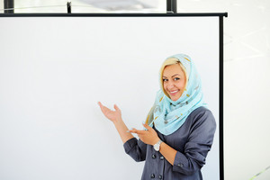 Arabic Muslim woman with copy space chart for presentation