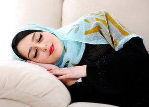 Arabic woman sleeping on sofa