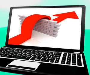 Arrow Jumping Wall On Laptop Shows Overcoming Obstacles