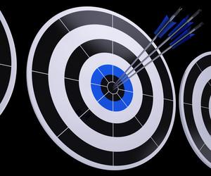 Arrows On Dartboard Shows Successful Hitting