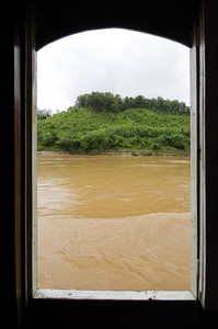 Asian river through boat window