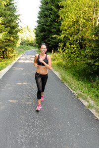 Athlete woman training for running race outdoor on sunny day