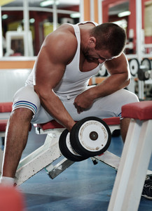 Athletic strong bodybuilder, execute exercise training in sport gym hall