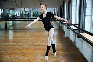 Attractive ballerina dancing in ballet class
