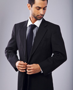 Attractive Businessman Buttoning His Coat