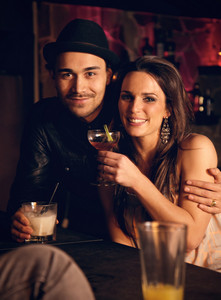Attractive couple with wine enjoying their drinks at the bar