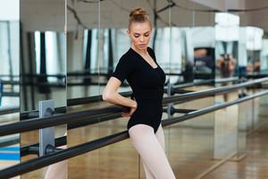 Attractive female dancer resting in ballet class