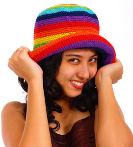 Attractive Teenager Smiling And Holding Her Hat
