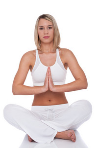 Attractive woman in yoga position on white background