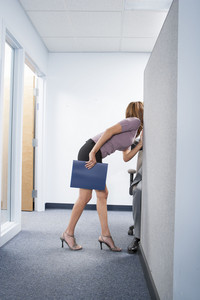 Attractive woman posing in office