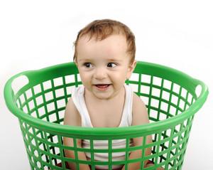 Baby boy in plastic box