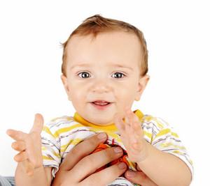 Baby In Parents Hands