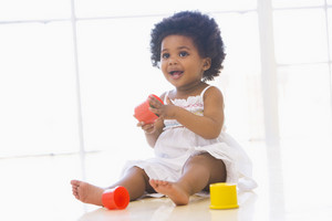 Baby indoors playing with cup toys