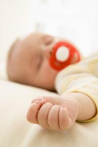 Baby lying indoors sleeping