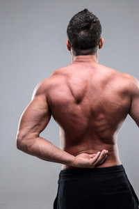 Back pain injury on fit adult man