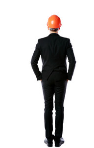 Back view portrait of a businessman in orange helmet standing over white background