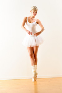 Ballerina exercising ballet pose in the studio woman beautiful dance