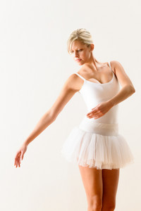Ballet dancer exercising dance move in studio woman ballerina pose