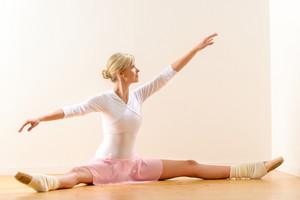 Ballet dancer lifting arms exercising in studio woman ballerina beautiful
