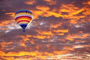 Balloon on Sunset / sunrise with clouds, light rays and other atmospheric effect