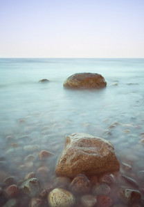 Baltic seascape with stones. Sea coastline at sunny day