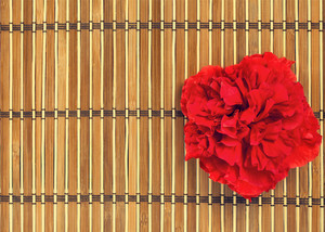 Bamboo pad for spa with red flower
