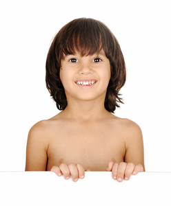 Bare-chested little boy looking at camera