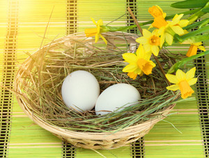 Basket with eggs and flowers