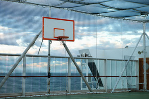 Basketball court and hoop with a view of the Atlantic ocean.