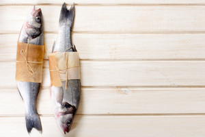 Bass Fishes On Wooden Background
