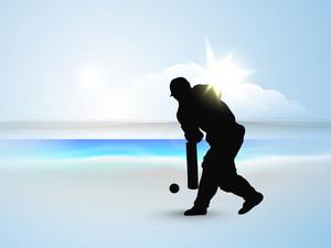 Batsman In Batting Action On At Seaside.