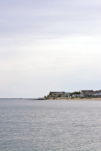 Beach homes or cottages lining the shoreline.