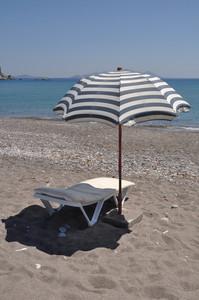 Guarda-sol e cadeira
