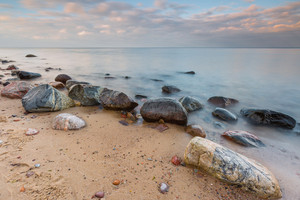 Beautifu rocky sea shore at sunrise or sunset. Long exposure landscape. Baltic sea near Gdynia in Poland.