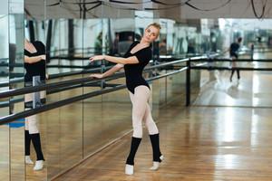Beautiful ballerina dancing in ballet class