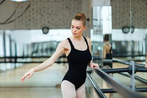 Beautiful ballerina practicing in ballet class