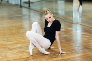 Beautiful ballerina practicing in ballet class