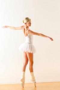 Beautiful ballet dancer dancing in the studio woman ballerina rehearsal