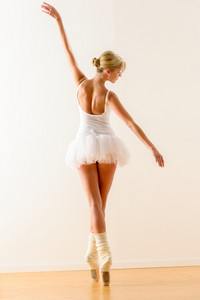 Beautiful ballet dancer dancing in the studio woman ballerina rehearsal